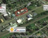 .59 AC Commercial w/ 3 Bldgs. 5,504 SFF Approx.